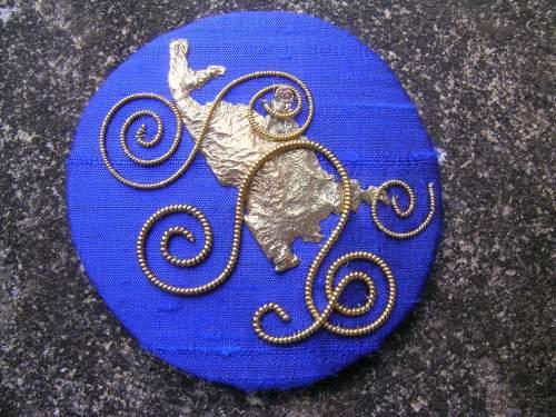 Blue spirals brooch