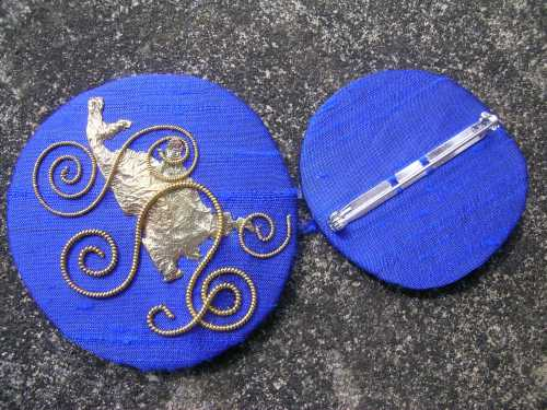 Blue spirals brooch with back
