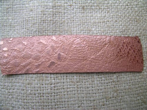 Lace texture on gilding metal