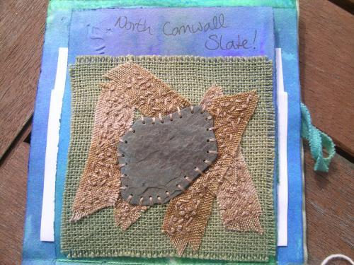 Stitched slate on sand 4
