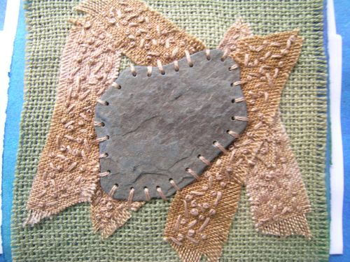 Stitched slate on sand 3