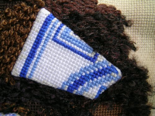 Blue and white tile shard 1