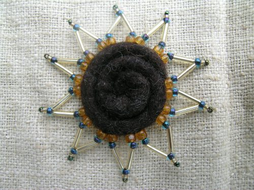 Brown, blue and gold spiral brooch 1