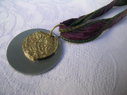 Reticulated brass and stainless steel pendant