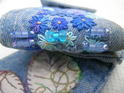 Denim cuff book beaded spine