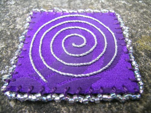 Purple square with beaded blanket stitch 2